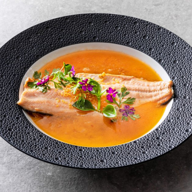 Pan fried Tasmanian ocean trout with a herbal sauce of white turmeric, school prawns, fish oils &a rich chicken stock.
