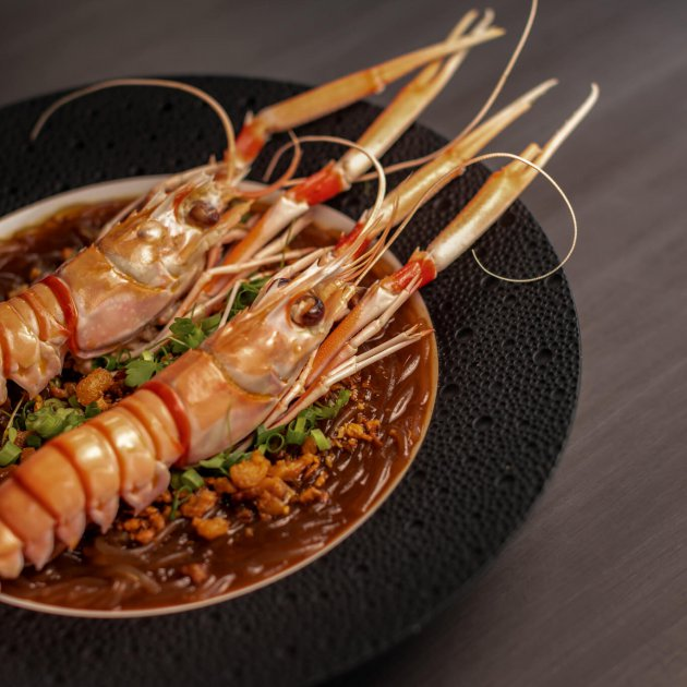 Roasted scampi, anise-myrtile spiced bacon and glass noodles